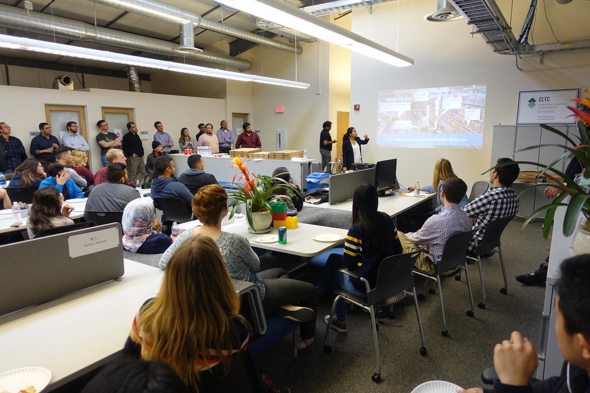 50 students and visitors listening to a lightning talk presentation at the spring 2018 data scholars project showcase